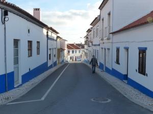 The bustling main street of Porto Covo