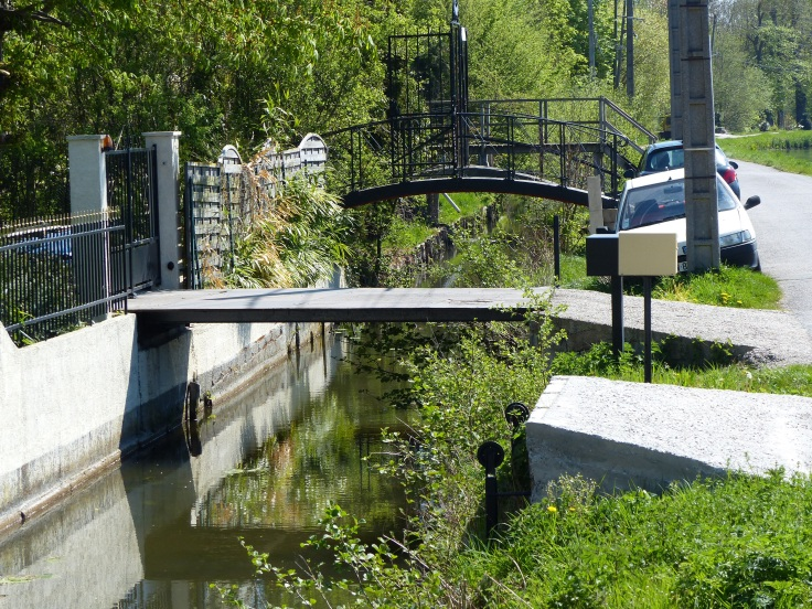 The little access bridges from the houses across the moat