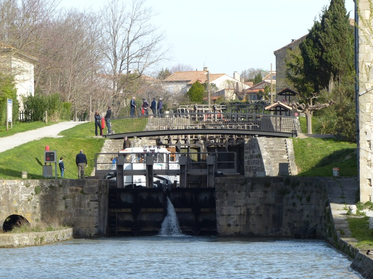 The lock beginning to open to let a boat through