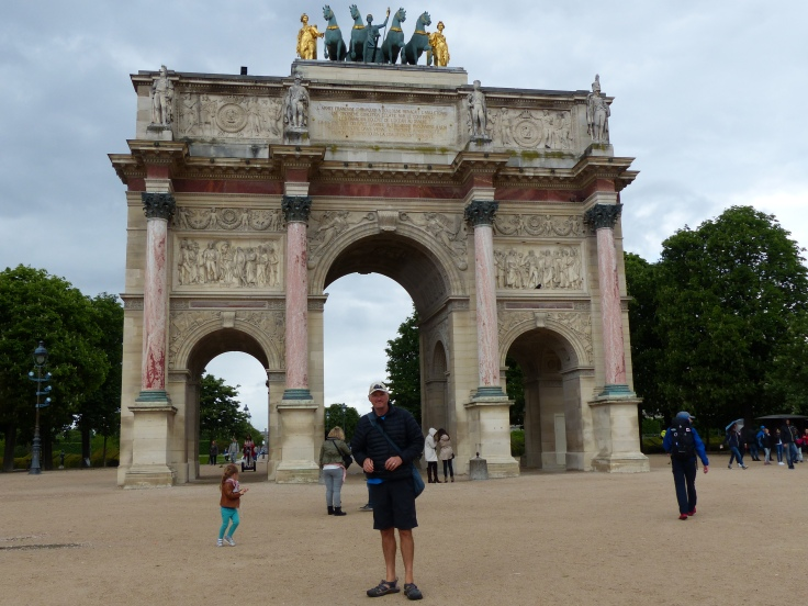 The arch leading into the park in front of The Louvre