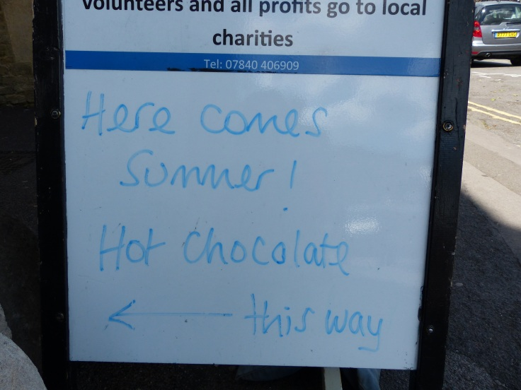 I think this sign outside a cafe says it all about English summer weather!
