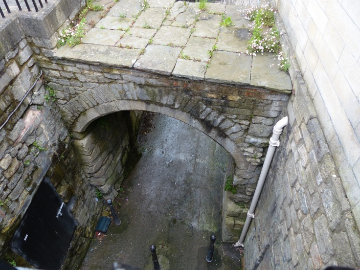 An arch from the original Roman street