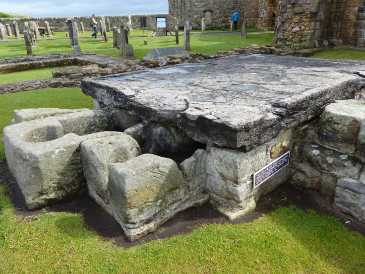 This was a grave slab. It's been moved to reveal the coffins underneath