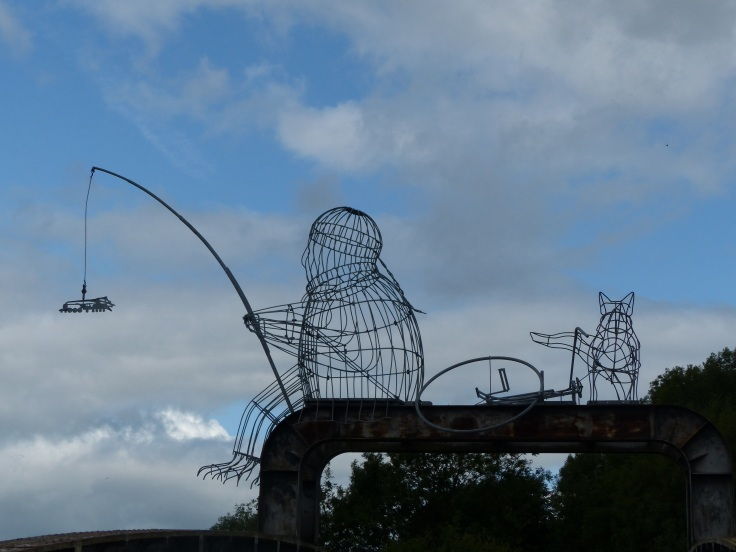 This sculpture sat above the cycle path. I loved the dog cocking its leg and on a bike no less!