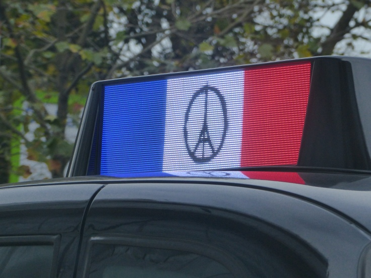We saw this on top of a black cab. I liked how they had made the Peace symbol from the Eiffel Tower