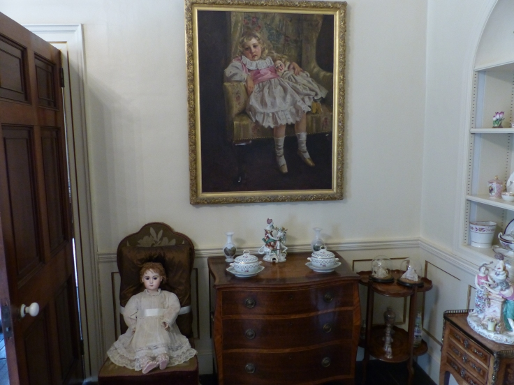 A painting of Agatha Christie as a four year old, and the actual doll she's holding in the painting