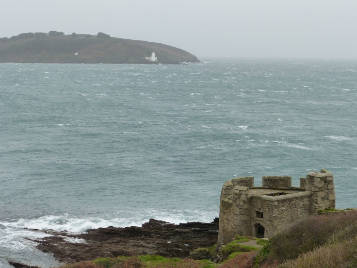 A glimpse of Pendennis Castle and the waves taking a battering