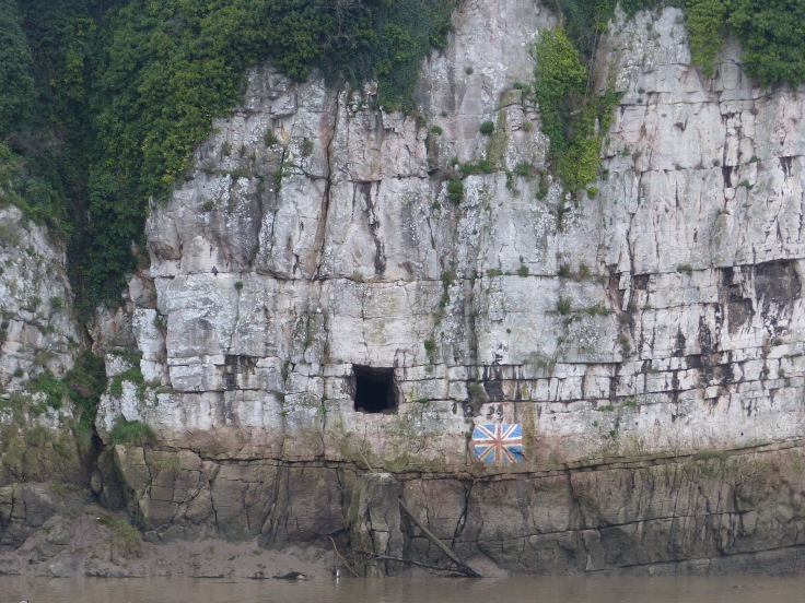 This is the Gloucester Hole, a naturally occurring cave, which is thought to have been  used to store tea by Quakers and gunpowder by the railways. The hole opens out into a large cavern inside the hill. I thought the painted Union Jack was modern day graffiti, but it was painted by some salmon fishermen in 1935 to make King George V's Silver Jubilee